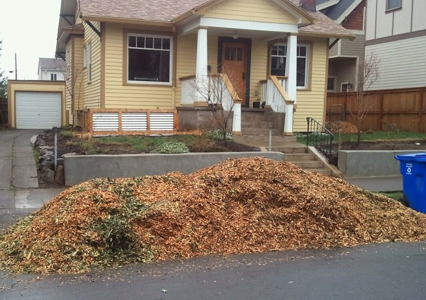 Wood chips in front of house